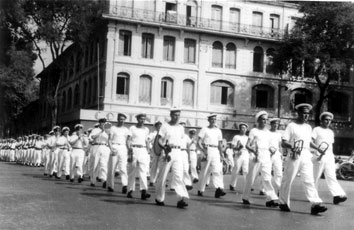 The French Navy Band of the Maritime Forces of the Far-East paraded on Catinat Street Saigon