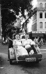 French tourists with cyclomotor in saigon