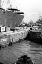 Unloading goods at the docks Saigon